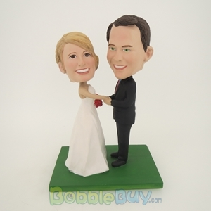 Picture of Groom Holding Bride's Hand Wedding Bobblehead