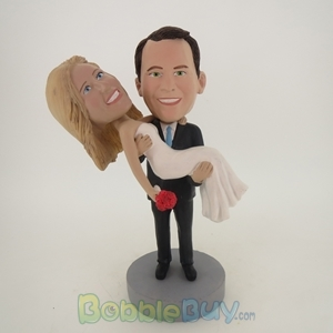 Picture of Groom Holds Wife Bobblehead