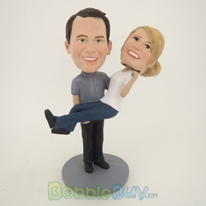 Picture of Man Holds Woman Bobblehead